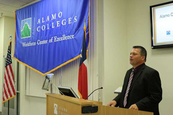 Mike McIver, Pressure Systems International manufacturing vice president, speaks during a graduation ceremony Wednesday in which existing workers received upgraded training from an Alamo Colleges program.
