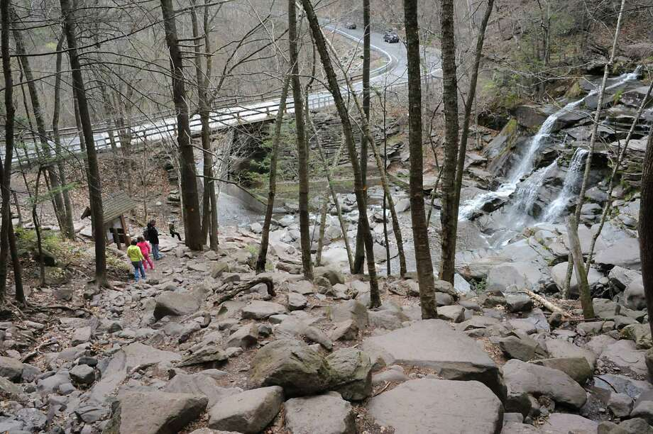 People hike the Kaaterskill Falls on Thursday, April 28, 2016 in Haines Falls, N.Y. (Lori Van Buren / Times Union) Photo: Lori Van Buren / 10036409A