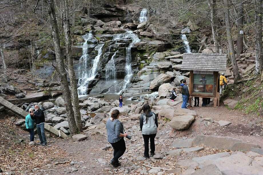 People visit and hike the Kaaterskill Falls on Thursday, April 28, 2016 in Haines Falls, N.Y. (Lori Van Buren / Times Union) Photo: Lori Van Buren / 10036409A