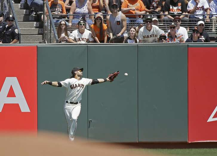 San Francisco Giants left fielder Angel Pagan misses a fly ball hit by the Cincinnati Reds' Eugenio Suarez in the fifth inning of a baseball game Wednesday, July 27, 2016, in San Francisco. Pagan was charged with an error on the play. (AP Photo/Eric Risberg)