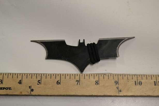 """A man was arrested on Capitol Hill Monday night after reportedly  hurling this """"batarang"""" at a patrol SUV while being chased by cops."""