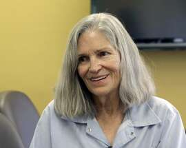 FILE - In this April 14, 2016 file photo, former Charles Manson follower Leslie Van Houten confers with her attorney Rich Pfeiffer, not shown, during a break from her hearing before the California Board of Parole Hearings at the California Institution for Women in Chino, Calif. California Gov. Jerry Brown is denying parole for Van Houten, the youngest follower of murderous cult leader Charles Manson. The Democratic governor said Friday, July 22, 2016, Van Houten�s �inability to explain her willing participation in such horrific violence� leads him to believe she remains an unreasonable risk to society. (AP Photo/Nick Ut, File)