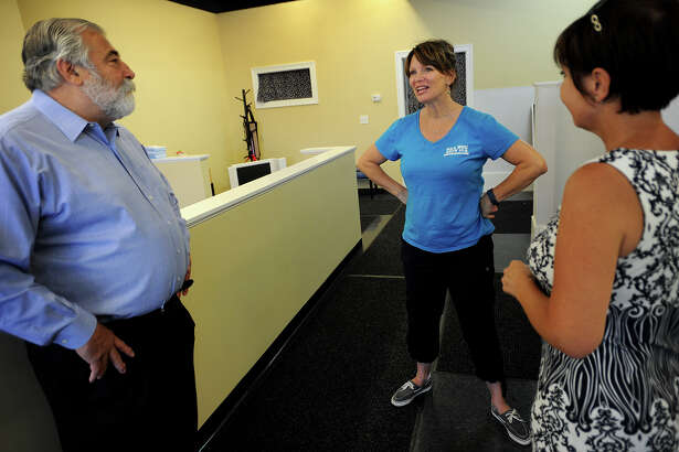 State representatives Charlie Ferraro, left and Pam Staneski, right, chat with Give a Dog a Bath owner Deborah Coelho at her business at 284 Boston Post Road in Milford, Conn. on Wednesday, July 27, 2016. Ferraro and Staneski met with small business owners across the city to ask about their concerns while passing out information about a new state mandated employee IRA savings plan.