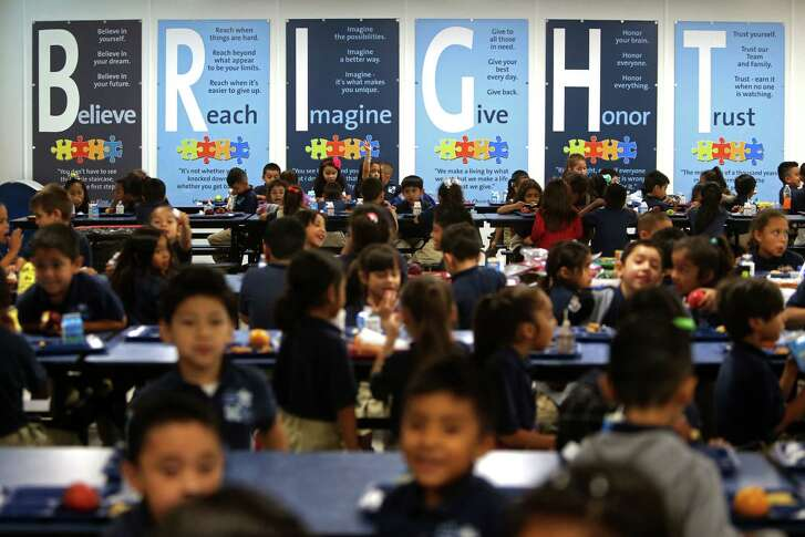 As KIPP Explore Academy students gather in the cafeteria, they are met with a wall of instruction to encourage them to be good citizens, perform at the highest level and to: Believe, Reach, Imagine, Give, Honor and Trust.