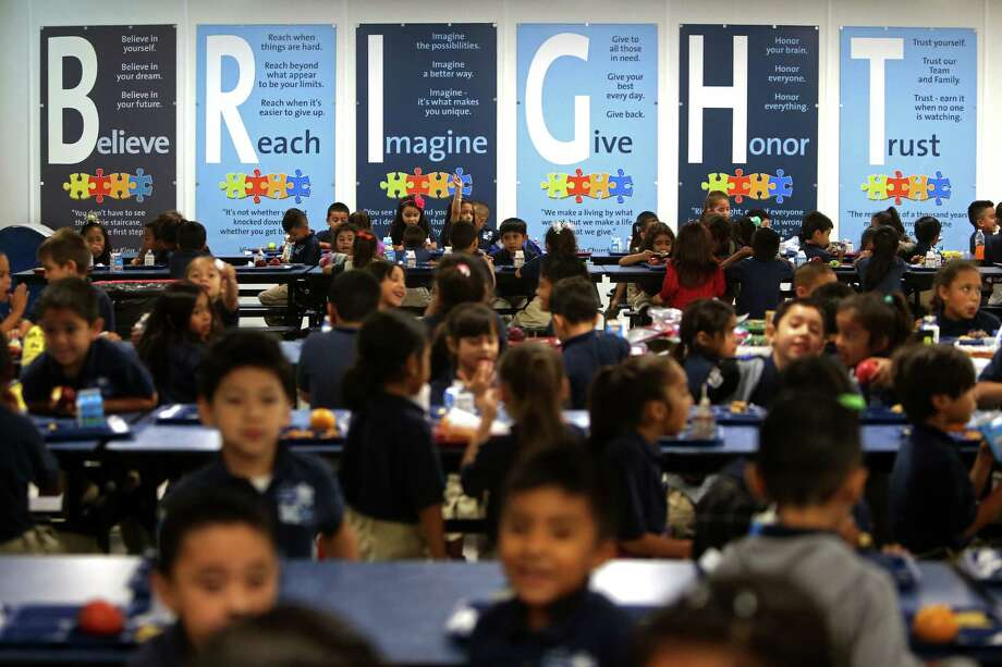 As KIPP Explore Academy students gather in the cafeteria, they are met with a wall of instruction to encourage them to be good citizens, perform at the highest level and to: Believe, Reach, Imagine, Give, Honor and Trust. Photo: Gary Coronado, Staff / © 2015 Houston Chronicle