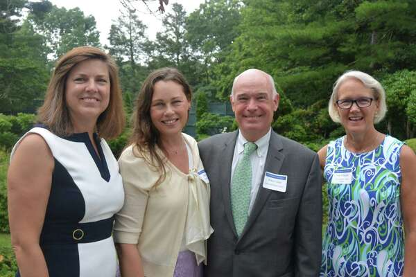 Carrie Bernier, executive director of the Community Fund of Darien (left), Robert Cashel, president & CEO of Family &Childrens Agency (center), and Community Fund of Darien staff at grants award ceremony, July 14.