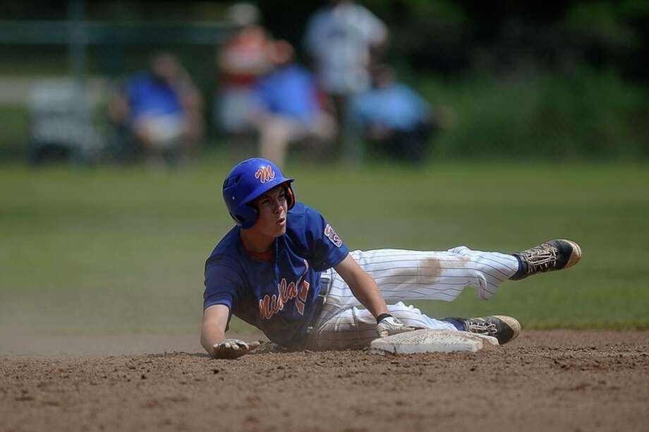 ERIN KIRKLAND | ekirkland@mdn.net Midland Junior All-Stars' Carter Knochel slides into second during a game against Three Rivers at the Junior League Baseball State Tournament in Larkin on Wednesday.