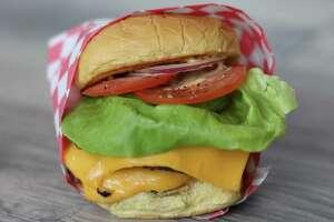 Chef Ryan Hildebrand of Triniti Restaurant & Sanctuari Bar will open FM burger in fall 2016 at 1112 Shepherd. Shown: FM Double.