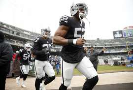 Oakland Raiders' Khalil Mack, Taylor Mays and Korey Toomer run onto the field to warm up before playing Kansas City Chiefs' during NFL game at O.co Coliseum in Oakland, Calif., on Sunday, December 6, 2015.