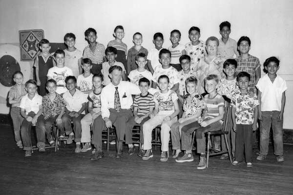 """1961: Officers elected to the Houston Street and Newsboys Club Inc. Sitting with Harris County Sheriff C.V. """"Buster"""" Kern is Lawrence Gallardo known by the boys as """"Butch."""" Also with them are Michael Estrada, captain, Robert Salthouse, sergeant, and Merle Salthouse, lieutenant.    The Houston Street and Newsboys Club was formed by the YMCA in 1919 to help boys who sold newspapers, shined shoes or basically made a living on the street. The kids met in a clubhouse, which contained a gym, a game room and a reading room all in an effort to keep the youths out of trouble. In the 1950s members of the club could receive medical, social and religious guidance. A newspaper, """"Newsboys in Action"""" was also published. The group also went camping annually in Palacios.     The group's clubhouse moved every so often. At various times, it was located on Dart Street, 1010 Commerce and at 106 1/2 Main.     By 1967, faced with dwindling membership, the group merged with the Variety Boys Club of Houston and gave up its name."""