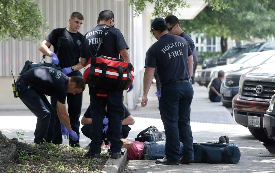Houston Fire Department personnel respond  to a call of a man down in a known drug area along Fannin and Wheeler near Peggy Park in Houston. ( Melissa Phillip / Houston Chronicle ) Photo: Melissa Phillip, Staff / © 2016 Houston Chronicle