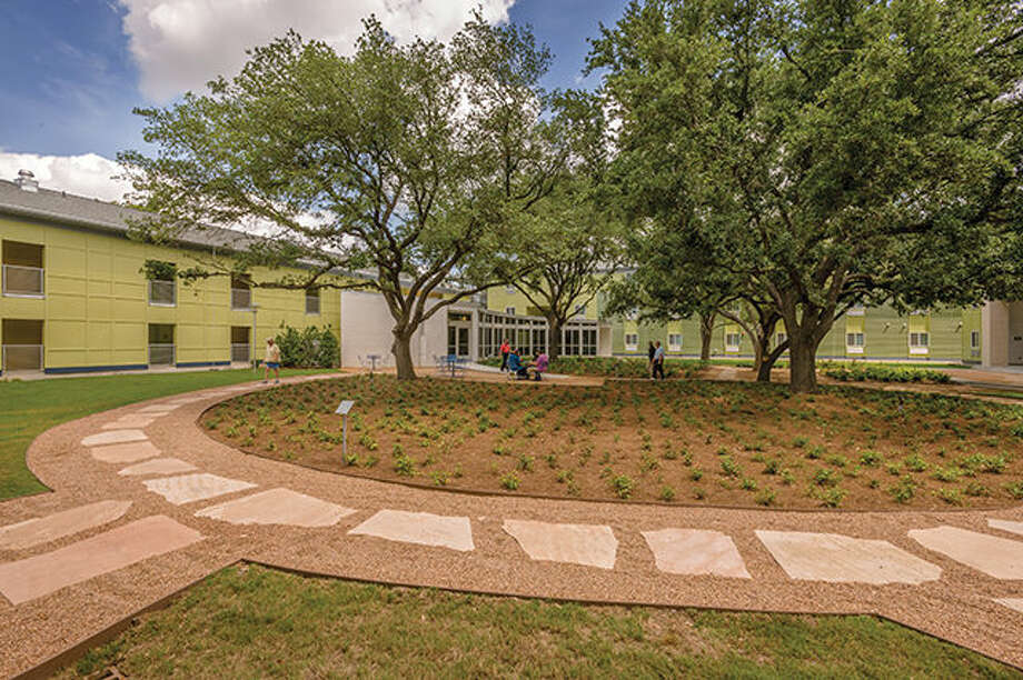 Here is the interior courtyard of New Hope Housing's Rittenhouse complex. Photo: Mark Hiebert. Photo: Mark Hiebert. / Copyright Mark Hiebert, Hiebert Photography. All Rights Reserved. No use without written permission. Call 281-961-3014 for licensing information or e-mail mhiebert@hiebertphotography.com.