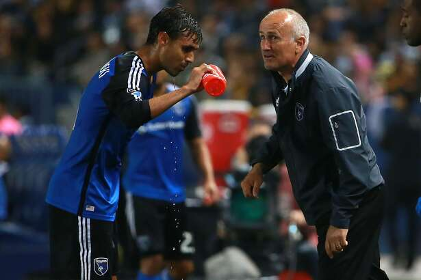CARSON, CA - MARCH 19: Head Coach Dominic Kinnear of the San Jose Earthquakes gives Chris Wondolowski #8 instructions during a break in action against the Los Angeles Galaxy in the second half of the MLS match at StubHub Center on March 19, 2016 in Carson, California. The Galaxy defeated the Earthquakes 3-1. (Photo by Victor Decolongon/Getty Images)