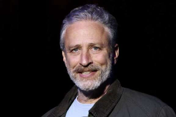 "FILE - In this Tuesday, Nov. 10, 2015, file photo, comedian Jon Stewart performs at the 9th Annual Stand Up For Heroes event, in New York. Stewart delivered a riff reminiscent of his ""Daily Show"" days during an appearance on CBS' ""Late Show with Stephen Colbert"" on July 21, 2016. (Photo by Greg Allen/Invision/AP, File)"