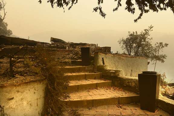 Smoke surrounds the ruins of a home that was destroyed by the Soberanes Fire in Palo Colorado Canyon on the northern Big Sur Coast on Tuesday July 26, 2016 in Big Sur, Calif. California's signature parks along the Big Sur coastline that draw thousands of daily visitors were closed Tuesday as one of the state's two major wildfires threatened the scenic region at the height of the summer tourism season. (David Royal/The Monterey County Herald via AP) MANDATORY CREDIT