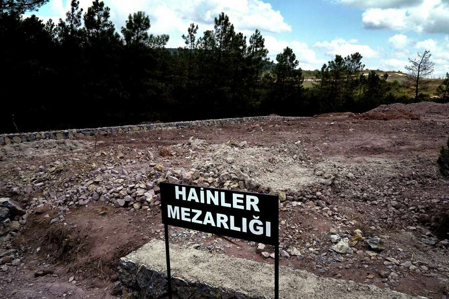 """A sign in front of a field of unmarked graves that reads """"Traitors' Cemetery"""" serves as a stark reminder of the failed coup attempt in Turkey on July 15 that cost the lives of more than 200 people. Photo: Bram Janssen, STR / Copyright 2016 The Associated Press. All rights reserved. This material may not be published, broadcast, rewritten or redistribu"""