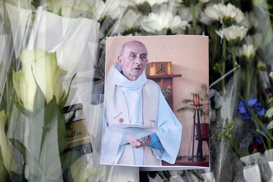 The town of St.-Étienne-du-Rouvray, France, is mourning the death of Rev. Jacques Hamel, who was killed Tuesday by two Islamic State followers. Photo: Francois Mori, STF / Copyright 2016 The Associated Press. All rights reserved. This material may not be published, broadcast, rewritten or redistribu