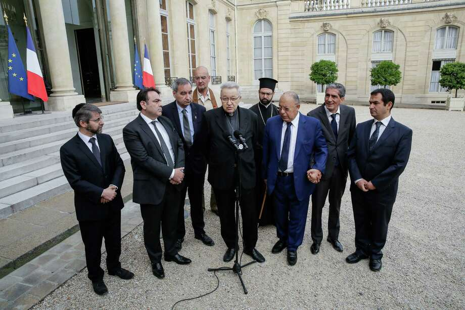 From left to right : France's Chief Rabbi Haim Korsia, French Jewish central Consistory President, Joel Mergui, President of Protestant Federation of France, Pastor Francois Clavairoly, President of the French Buddhist Union, Olivier Reigen Wang-Genh, French Cardinal, Andre Vingt-Trois, General Vicar of the Greek Orthodox metropolis, Grigorios Ioannidis, rector of the Great Mosque of Paris, Dalil Boubakeur, Boubakeur's aid and the vice-president of the French Council of The Muslim Faith, Ahmet Ogras, adresss the media after a meeting with French President, Francois Hollande, following yesterday attack at a church in Normandy, Wednesday, July 27, 2016. The Islamic State group crossed a new threshold Tuesday in its war against the West, as two of its followers targeted a church in Normandy, slitting the throat of an elderly priest celebrating Mass and using hostages as human shields before being shot by police. (AP Photo/Thomas Padilla) Photo: Thomas Padilla, STR / AP