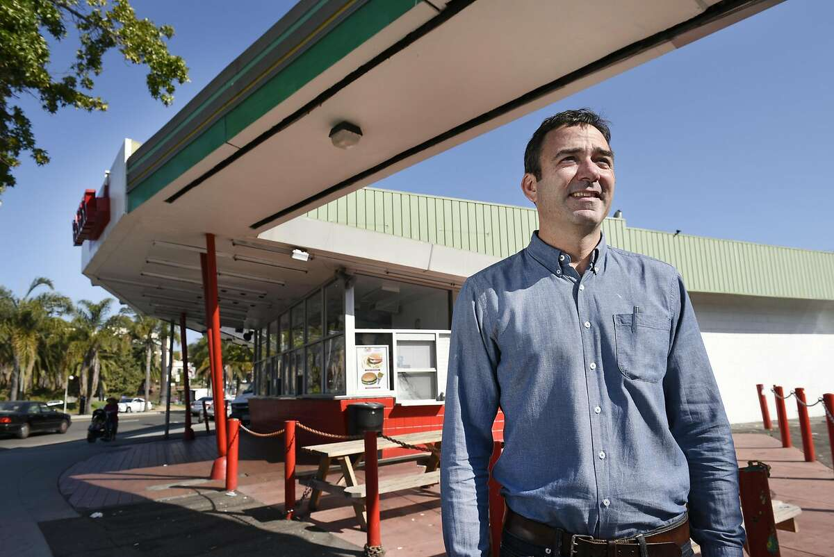 Architect Ken Lowney in front of the Kwik Way Diner, which is currently housing the Merritt Bakery, in Oakland. The building's owner, Alex Hahn, is pushing plans to turn it into a mixed-use project with three stories of housing, two stories of parking and 3,000 square feet of retail.
