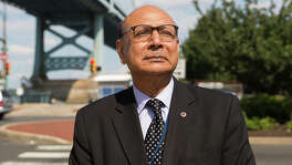 07/26/16 Philadelphia, PA  Khizr Khan in town to speak at the DNC stands in front of Philadelphia's Benjamin Franklin bridge.  Khan is the father of a Muslim American soldier who died in Iraq.