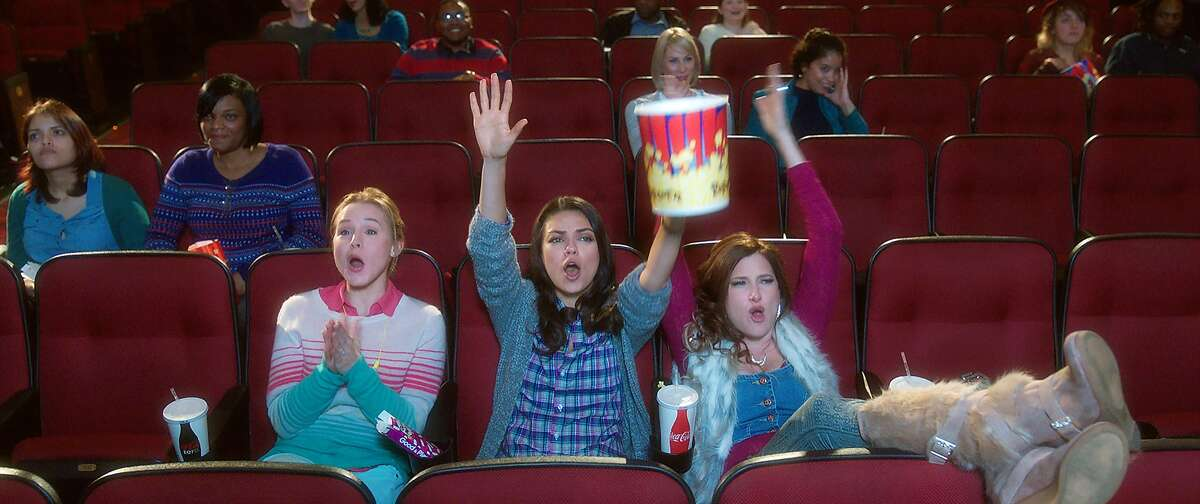 This image released by STX Productions shows, from left, Kristen Bell, Mila Kunis and Kathryn Hahn in a scene from,