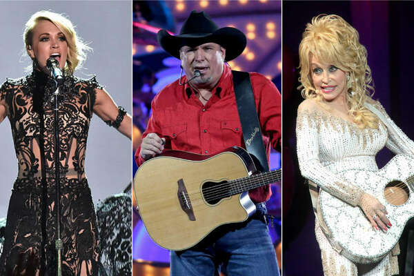 Garth Brook, shown at Houston's Toyota Center in June, tops Forbes' list of highest-paid country stars. Keep clicking to see how much he and others on the list made.