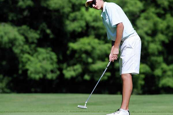 Ben Ropiak, 15, putts on the 18th green during the Town of Greenwich Joe Felder Junior Golf Tournament at the Griffith E. Harris Golf Course on Wednesday. Ropiak won the Boys 18-hole, 14-17 year-old division.