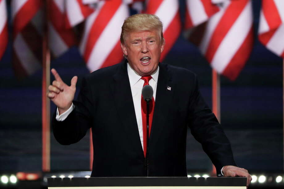 CLEVELAND, OH - JULY 21:  Republican presidential candidate Donald Trump delivers a speech during the evening session on the fourth day of the Republican National Convention on July 21, 2016 at the Quicken Loans Arena in Cleveland, Ohio. Republican presidential candidate Donald Trump received the number of votes needed to secure the party's nomination. An estimated 50,000 people are expected in Cleveland, including hundreds of protesters and members of the media. The four-day Republican National Convention kicked off on July 18.  (Photo by Alex Wong/Getty Images) ORG XMIT: 655470145 Photo: Alex Wong / 2016 Getty Images