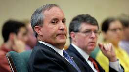 FILE - In this July 29, 2015 file photo, Texas Attorney General Ken Paxton looks during a hearing in Austin, Texas. Federal securities regulators have filed civil fraud charges against Paxton, Monday, April 11, 2016, over recruiting investors to a high-tech startup before becoming the state's top prosecutor. (AP Photo/Eric Gay)