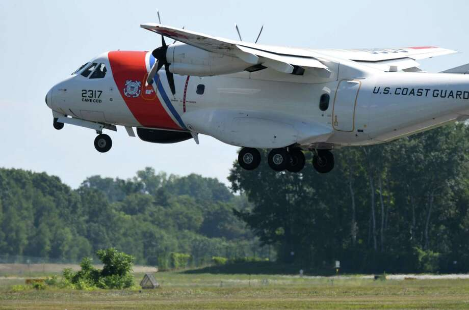 A Cape Cod based U.S. Coast Guard HC-144A Ocean Sentry fixed-wing aircraft makes a touch-and-go landing at Albany International Airport on Wednesday, July 27, 2016, in Colonie, N.Y. (Will Waldron/Times Union) Photo: Will Waldron