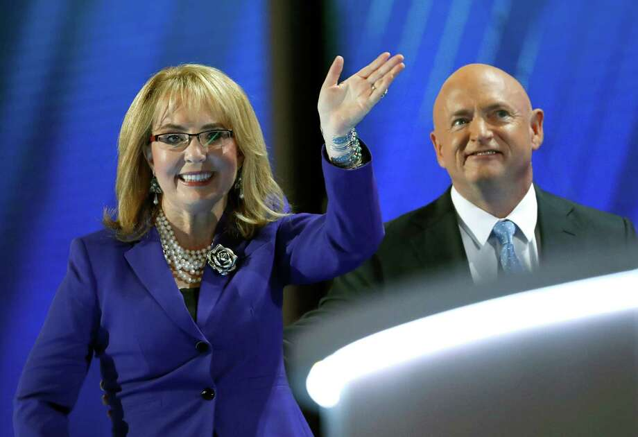 Former Rep. Gabby Giffords, D-Ariz, and her husband Astronaut Mark Kelly (Ret.), exit the stage after speaking during the third day of the Democratic National Convention in Philadelphia , Wednesday, July 27, 2016. (AP Photo/Paul Sancya) Photo: Paul Sancya, Associated Press / Copyright 2016 The Associated Press. All rights reserved. This material may not be published, broadcast, rewritten or redistribu