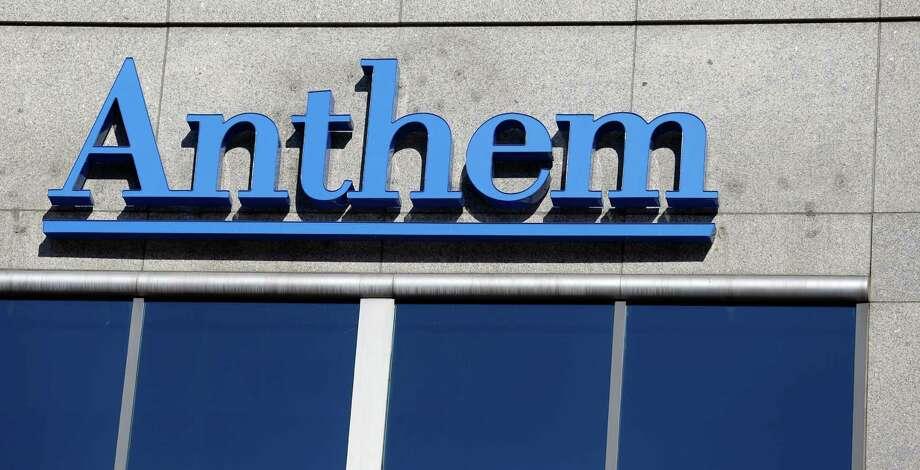 FILE - This Feb. 5, 2015 file photo shows the Anthem logo at the health insurer's corporate headquarters in Indianapolis. Anthem is buying rival Cigna, in a deal valued at $54.2 billion announced Friday, July 24, 2015, that will create the nation's largest health insurer by enrollment, covering about 53 million patients in the U.S.  (AP Photo/Michael Conroy, File) ORG XMIT: NY111 Photo: Michael Conroy / AP