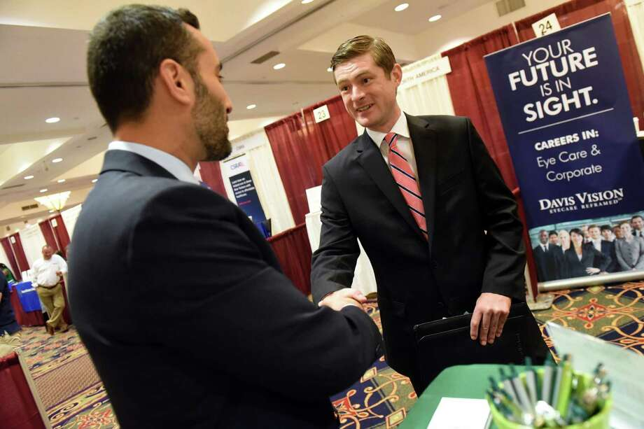 Eli Rabinowitz of Pioneer Bank, left, shakes hands with Delmar native Chris Bub after an informal interview during the Times Union Summer Job Fair on Wednesday, July 27, 2016, at Albany Marriott Hotel in Colonie, N.Y. Bub, who's working in Rochester, is looking to relocate back to the Capital Region. (Cindy Schultz / Times Union) Photo: Cindy Schultz / Albany Times Union