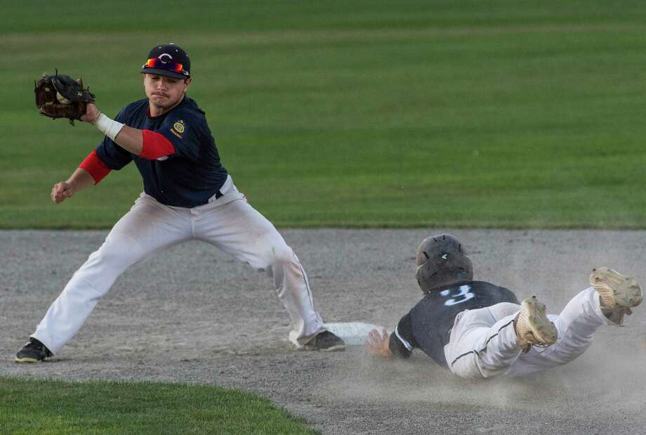 Stamford's Michael White slides safely into second as Cheshire's Altrin Kabashi doesn't get the tag down in time during the 19U American Legion Baseball State playoffs held at Palmer Field, Middletown, CT on Wednesday, July 27, 2016. Photo: Mark Conrad, For Hearst Connecticut Media / Stamford Advocate Freelance