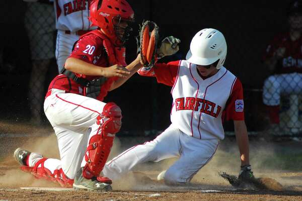 Fairfield American's Ben Gaffney reaches home plate as Berlin catcher Jon D'Amore tries to tag him, during Connecticut Little League State Championship action in Manchester, Conn. on Wednesday July 27, 2016. Gaffney was called safe in the play. Fairfield American beat Berlin 20-7.