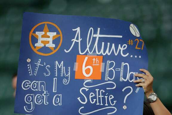 Kingslei Saenz, 5, tries to get Jose Altuve's attention during batting practice before the start of an MLB game at Minute Maid Park, Wednesday, July 27, 2016, in Houston. ( Karen Warren  / Houston Chronicle )