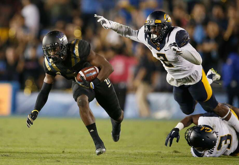 PASADENA, CA - OCTOBER 22:  Wide receiver Devin Fuller #7 of the UCLA Bruins eludes the tackle of cornerback Darius Allensworth #2 of the California Golden Bears and cornerback Cameron Walker #3 of the California Golden Bears during the third quarter of a game at Rose Bowl on October 22, 2015 in Pasadena, California.  (Photo by Sean M. Haffey/Getty Images) Photo: Sean M. Haffey, Getty Images