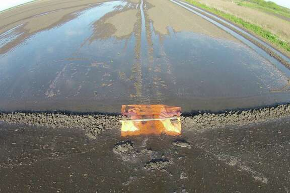 Bay City rice farmer Scott Savage uses drones to look for water leakage on his family's 2,500 acres of rice fields. He used his drone to take this photo, which shows a plastic levee in use to help with water control.