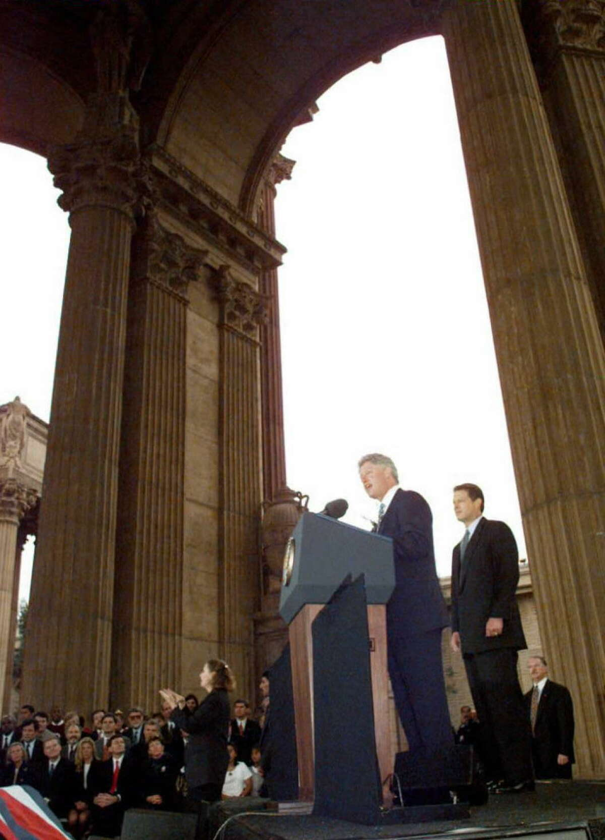 1995: US President Bill Clinton, center, announces a program to wire every California school with computers during a speech at the outdoor rotunda of the Exploratorium in San Fransisco, California, 21 September. Vice President Al Gore stands behind President Clinton. Both the president and vice president were wrapping up a four-state fundraising trip.