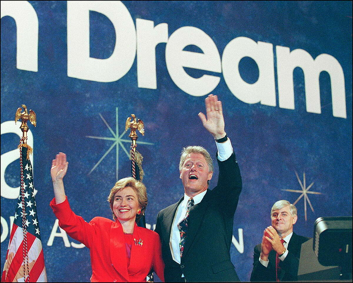 1993: US President Bill Clinton, center, in a picture dated 05 July 1993 in San Francisco and his wife, Hillary, wave to Arkansas delegation at NEA Convention.