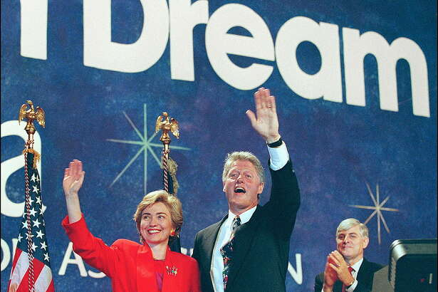 SAN FRANCISCO, UNITED STATES:  US President Bill Clinton (c) in a picture dated 05 July 1993 in San Francisco and his wife Hillary wave to Arkansas delegation at NEA Convention. (Photo credit should read LUKE FRAZZA/AFP/Getty Images)