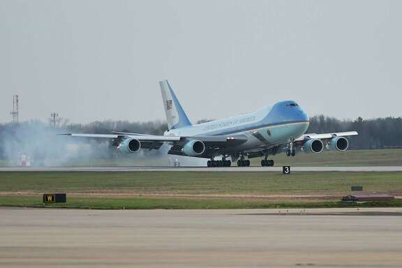 "Air Force One, a 747, lands at Andrews Air Force Base in Maryland. ""It is reasonably possible we could decide to end production of the 747,"" Boeing says."