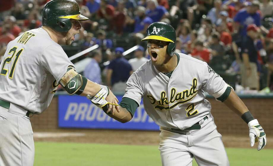 Oakland Athletics Khris Davis (2) celebrates his two-run home run with Stephen Vogt during the eighth inning of a baseball game against the Texas Rangers in Arlington, Texas, Wednesday, July 27, 2016. (AP Photo/LM Otero) Photo: LM Otero, Associated Press