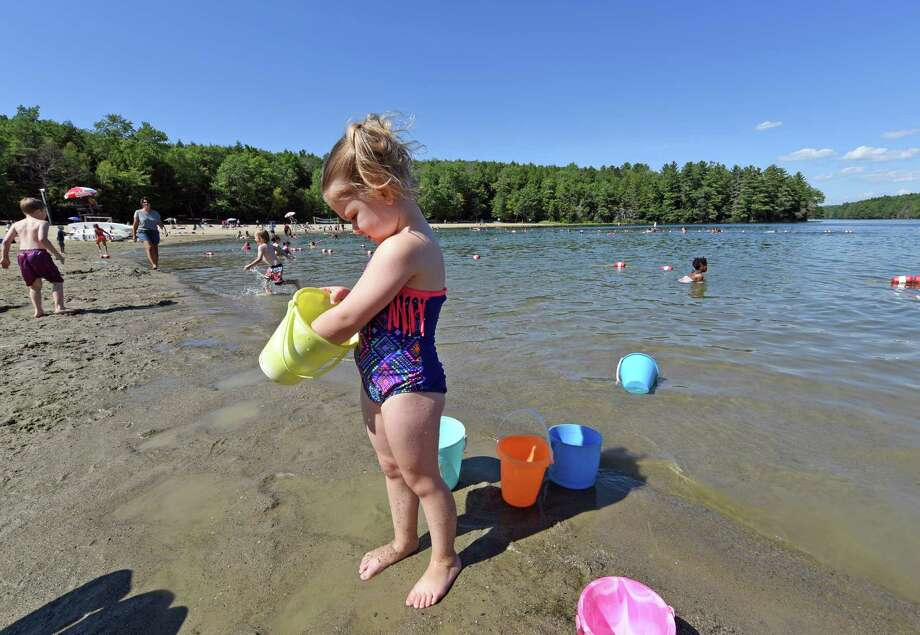 Four-year-old Zoey McFarland of West Sand Lake plays in the sand and water at Grafton Lakes State Park on Wednesday July 27, 2016 in Grafton, N.Y. State swimming areas will have extended hours through Thursday during the current heat wave. (Michael P. Farrell/Times Union) Photo: Michael P. Farrell / 20037449A