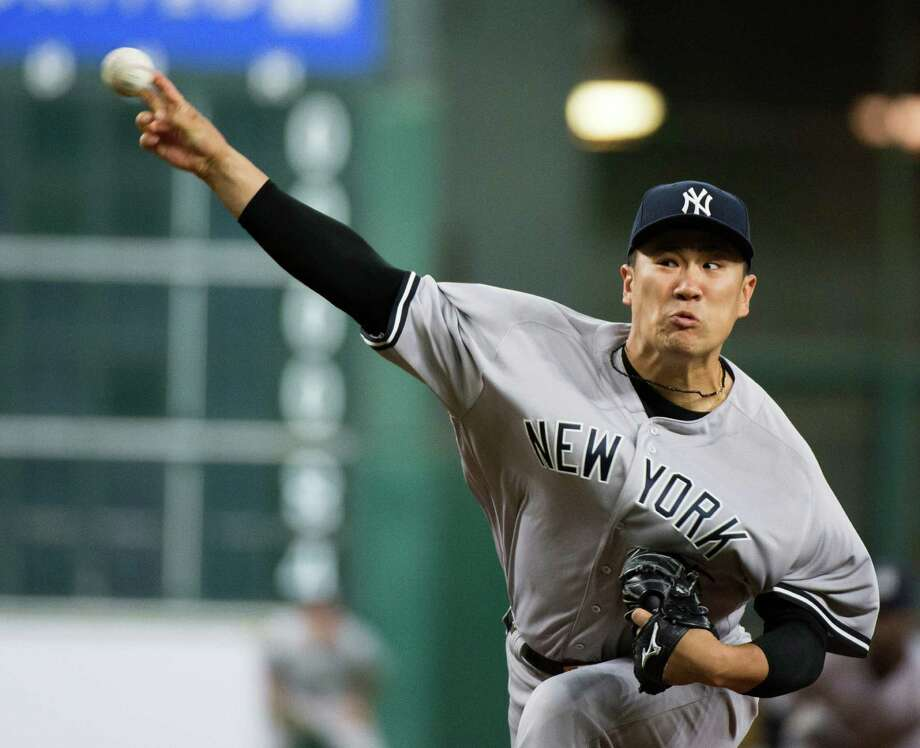 New York Yankees starter Masahiro Tanaka pitches against the Houston Astros during the first inning of a baseball game Wednesday, July 27, 2016, in Houston. (AP Photo/George Bridges) ORG XMIT: TXGB103 Photo: George Bridges / FR171217 AP