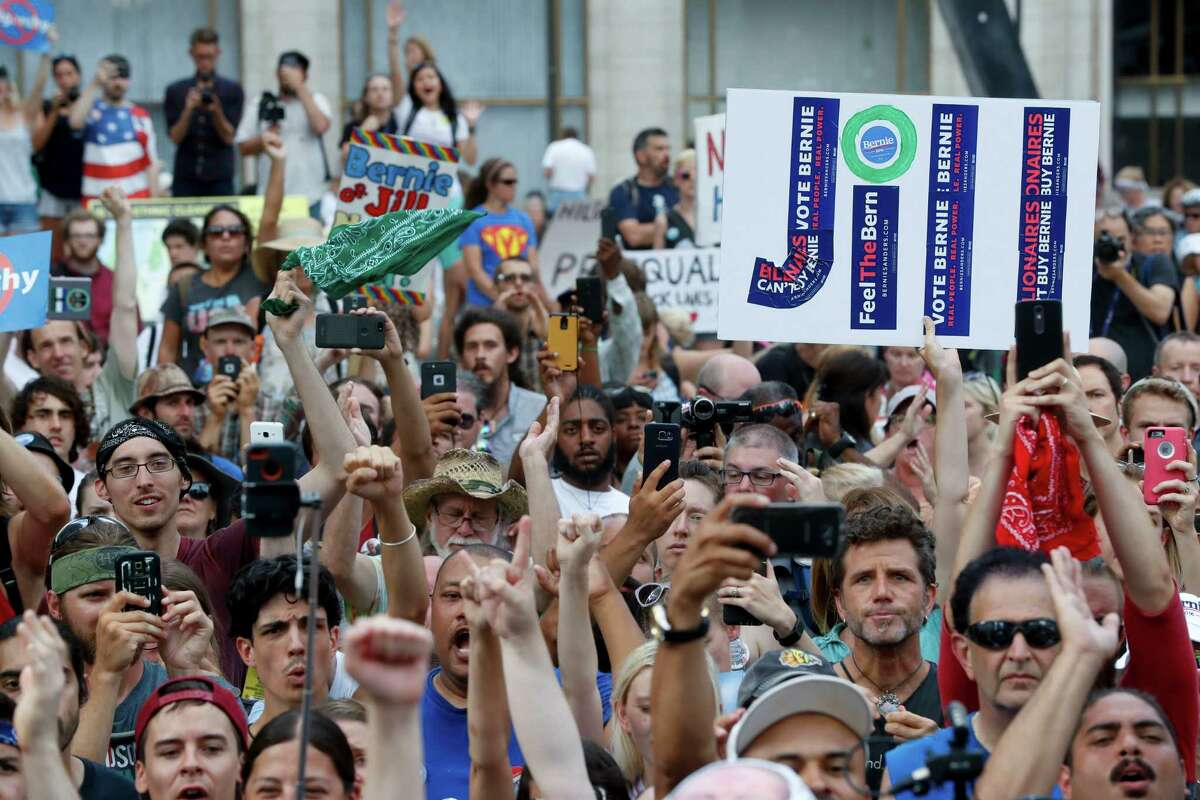 Supporters cheer as Dr. Jill Stein, presumptive Green Party presidential nominee, speaks at a rally in Philadelphia, Wednesday, July 27, 2016, during the third day of the Democratic National Convention. (AP Photo/John Minchillo) ORG XMIT: DNC728