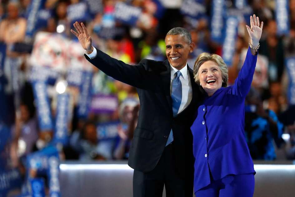 President Barack Obama and Democratic presidential candidate Hillary Clinton wave to the crowd on the third day of the Democratic National Convention at the Wells Fargo Center, July 27, 2016 in Philadelphia, Pennsylvania.