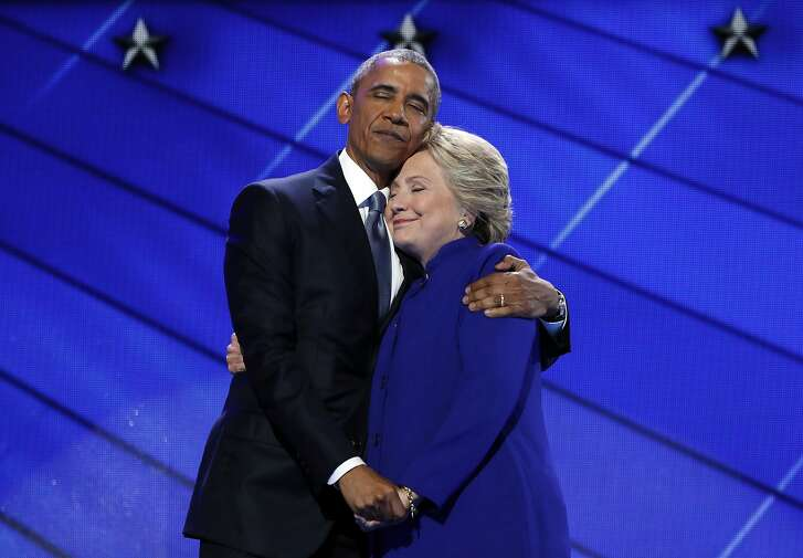 President Barack Obama hugs Democratic Presidential candidate Hillary Clinton after addressing the delegates during the third day session of the Democratic National Convention in Philadelphia, Wednesday, July 27, 2016. (AP Photo/Carolyn Kaster)