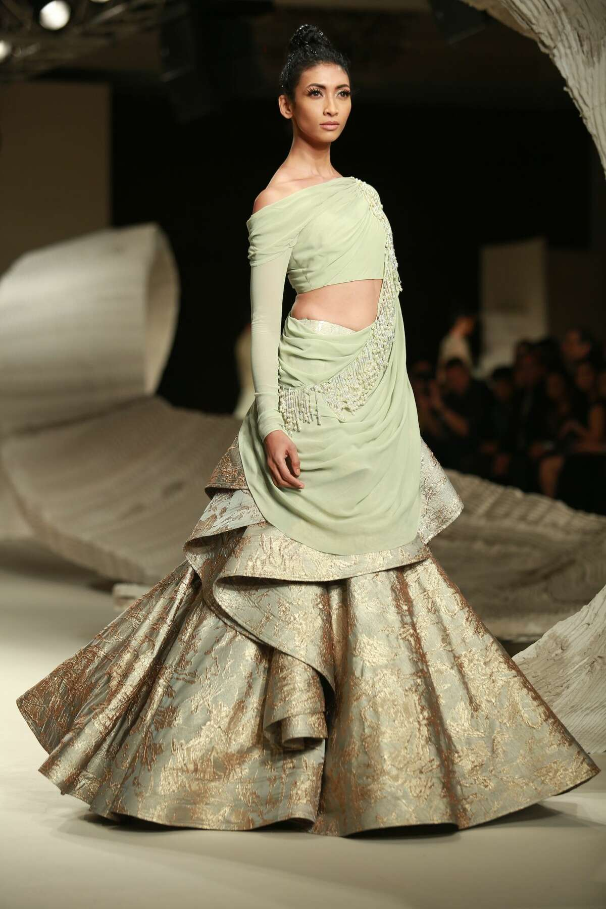 India Couture Week in New Delhi is bringing us some amazing fashions. Click through the slideshow for a few of our favorite looks. This photo: We're going to dub this the tornado skirt. The draping is glorious, with a tiny tornado coming down the side.