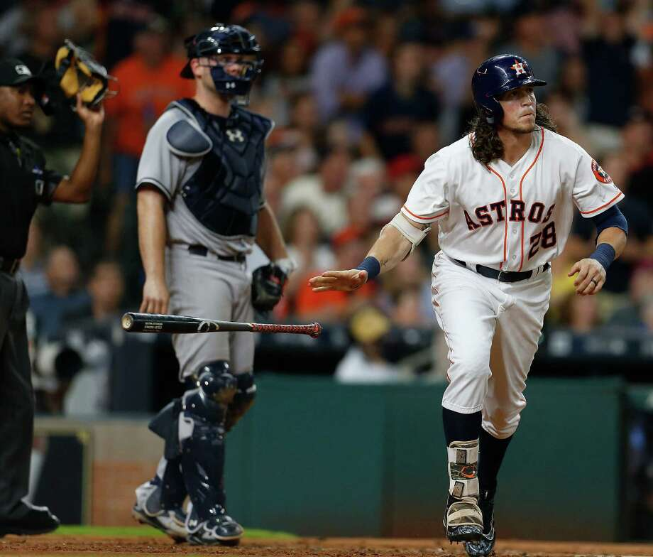 The Astros' Colby Rasmus, right, provides the biggest blow Wednesday night with a two-run homer in the third. Photo: Karen Warren, Staff / © 2016 Houston Chronicle